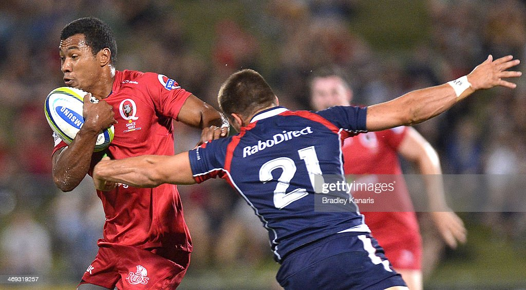 Aidan Toua of the Reds attempts to break away from the defence during the Super Rugby trial match between the Queensland Reds and the Melbourne Rebels at Ballymore Stadium on February 14, 2014 in Brisbane, Australia.