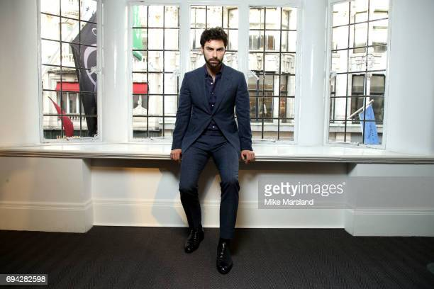 Aidan Turner attends London Fashion Week Men's June 2017 collections on June 9 2017 in London England