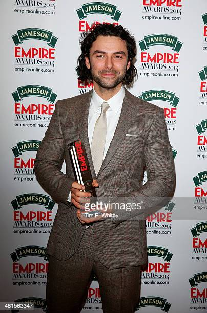 Aidan Turner with the Best Male Newcomer award presented by Tresor Paris for 'The Hobbit The Desolation Of Smaug' during the Jameson Empire Awards...