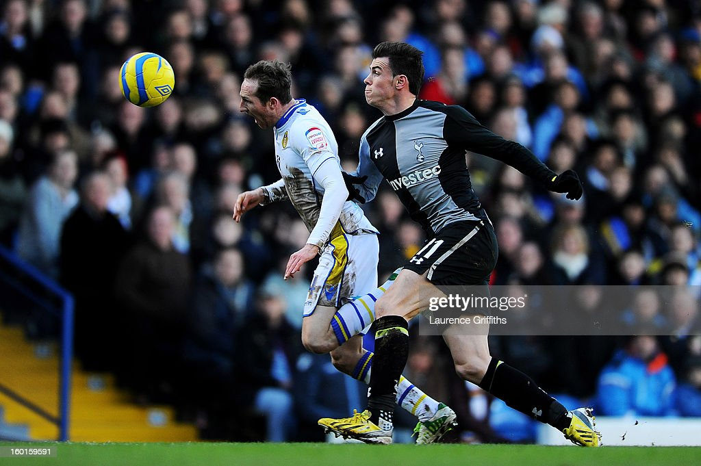 Aidan White of Leeds and Gareth Bale of Spurs compete for the ball during the FA Cup with Budweiser Fourth Round match between Leeds United and Tottenham Hotspur at Elland Road on January 27, 2013 in Leeds, England.