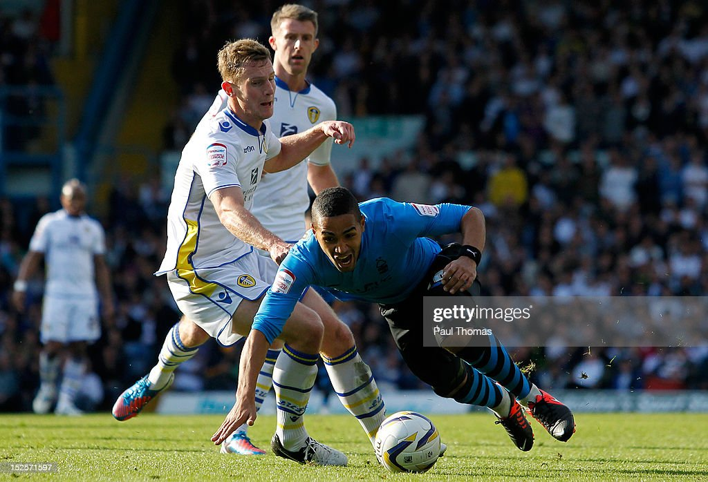 Aidan White (L) of Leeds fouls Lewis McGugan of Nottingham during the npower Championship match between Leeds United and Nottingham Forest at Elland Road on September 22, 2012 in Leeds, England.