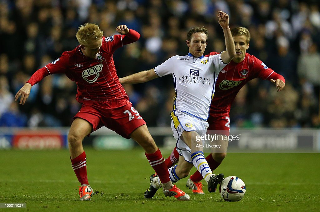 Aidan White of Leeds United is challenged by Ben Reeves of Southampton during the Capital One Cup Fourth Round match between Leeds United and Southampton at Elland Road on October 30, 2012 in Leeds, England.