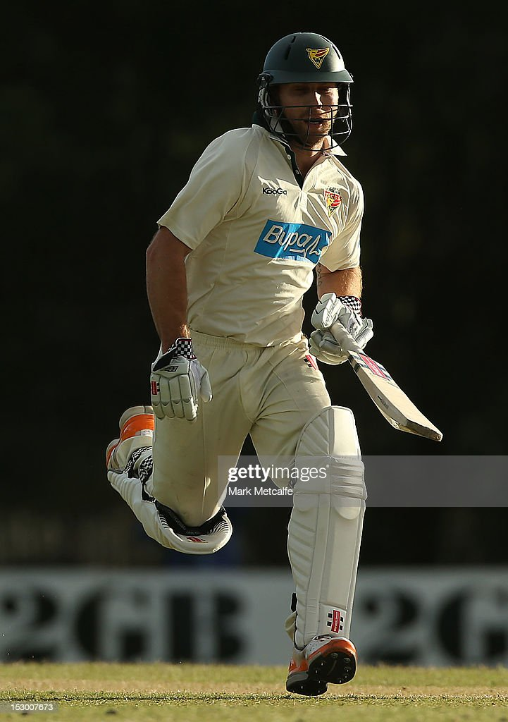 Aiden Blizzard of Tasmania runs between wickets during day four of the Sheffield Shield match between the New South Wales Blues and the Tasmanian Tigers at Bankstown Oval on September 29, 2012 in Sydney, Australia.