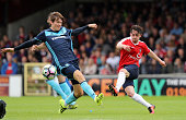 Aiden Connelly of York Ctiy shoots past Marten de Roon during the pre season friendly match between York City and Middlesbrough at Bootham Crescent...