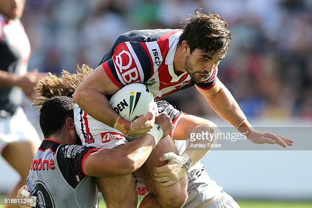 Aiden Guerra of the Roosters is tackled by the Warriors defence during the round five NRL match between the Sydney Roosters and the New Zealand...