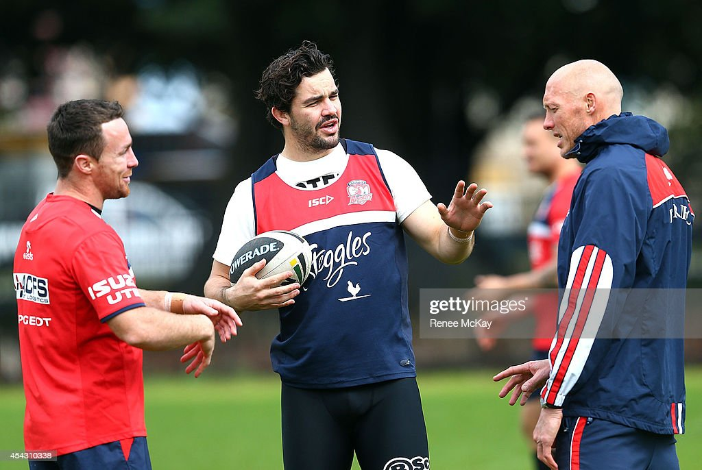 Aiden Guerra talks with James Maloney and Craig Fitzgibbon during the Sydney Roosters NRL training session at Kippax Lake on August 29, 2014 in Sydney, Australia.
