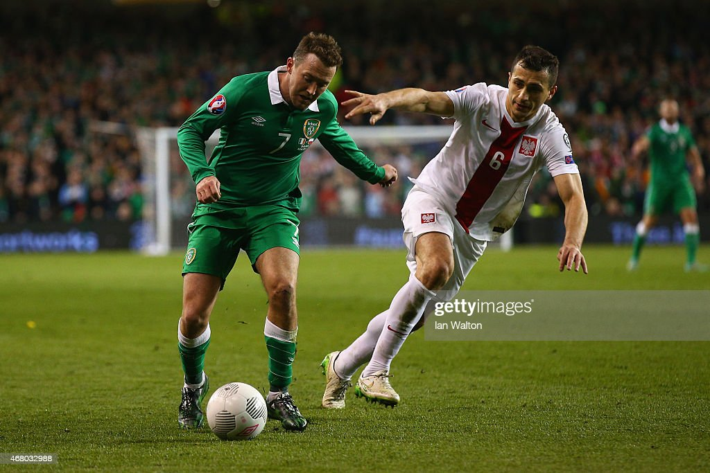 <a gi-track='captionPersonalityLinkClicked' href=/galleries/search?phrase=Aiden+McGeady&family=editorial&specificpeople=713430 ng-click='$event.stopPropagation()'>Aiden McGeady</a> of Republic of Ireland and <a gi-track='captionPersonalityLinkClicked' href=/galleries/search?phrase=Tomasz+Jodlowiec&family=editorial&specificpeople=5700915 ng-click='$event.stopPropagation()'>Tomasz Jodlowiec</a> of Poland compete for the ball during the EURO 2016 Qualifier match between Republic of Ireland and Poland at Aviva Stadium on March 29, 2015 in Dublin, Ireland.