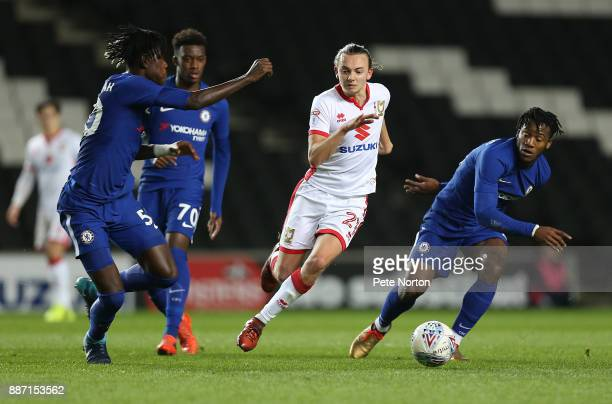 Aiden Nesbitt of Milton Keynes Dons moves between Trevoh Chalobah and Michy Batshuayi of Chelsea during the Checkatrade Trophy Second Round match...