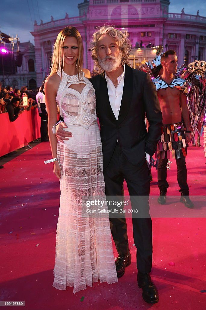 Aiden Shaw and model attend the 'Life Ball 2013 - Magenta Carpet Arrivals' at City Hall on May 25, 2013 in Vienna, Austria.