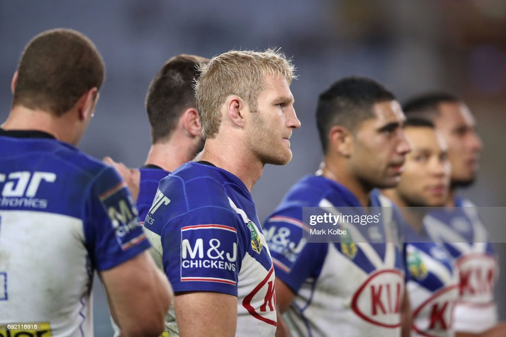 Aiden Tolman of the Bulldogs and his team look dejected after a Panthers try during the round 13 NRL match between the Canterbury Bulldogs and the Penrith Panthers at ANZ Stadium on June 4, 2017 in Sydney, Australia.