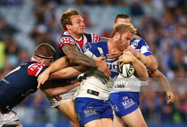 Aiden Tolman of the Bulldogs is tackled during the round 11 NRL match between the CanterburyBankstown Bulldogs and the Sydney Roosters at ANZ Stadium...