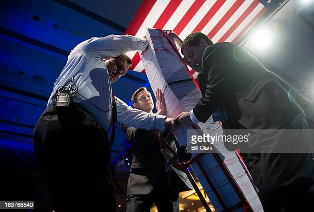 Aides wheel out a tower of 20000 pages of health care rules and regulations as a prop for the speech by Senate Minority Leader Mitch McConnell RKy at...