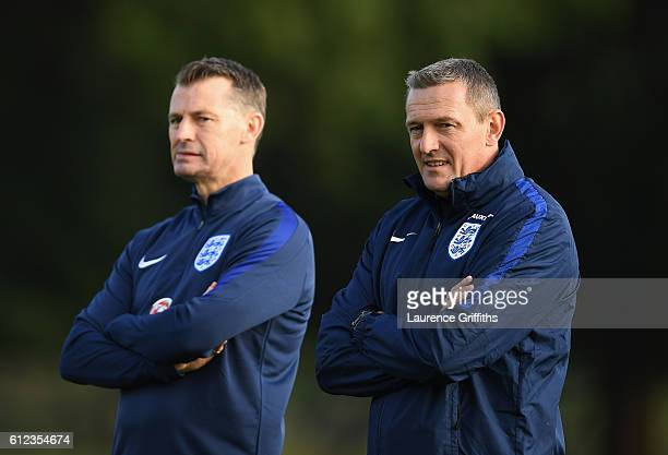 Aidy Boothroyd of England U21 looks on with Colin Cooper during a training session at St Georges Park on October 4 2016 in BurtonuponTrent England