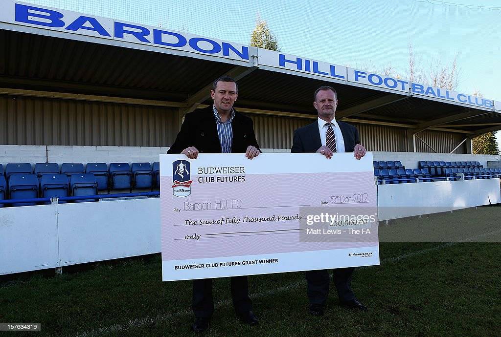 Aidy Boothroyd the regional Club Futures ambassador for the East Midlands, presents Shaun Forrester, Club Chairman of Bardon Hill FC with their winning cheque during the Bud Club Futures event at Bardon Hill FC on December 5, 2012 in Coalville, England. Football life is set to change for Bardon Hill as Newcastle United boss Alan Pardew, Budweiser and The FA have today announced the winners of the £50,000 grants as part of the Budweiser Club Futures programme.