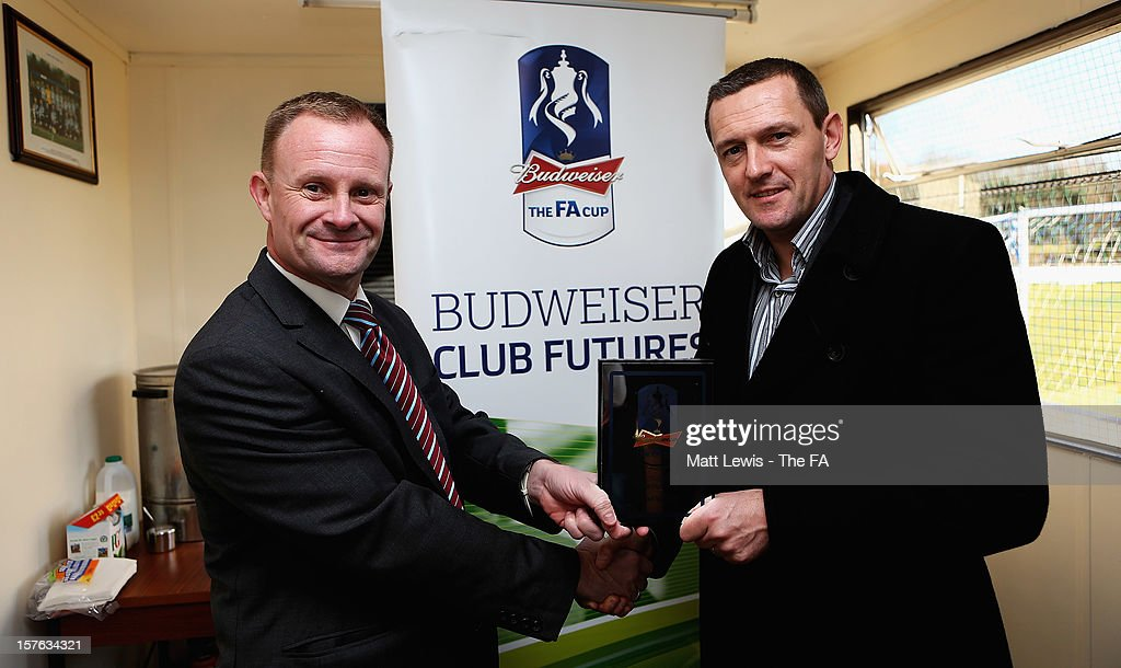 Aidy Boothroyd the regional Club Futures ambassador for the East Midlands, presents Shaun Forrester, Club Chairman of Bardon Hill FC with their winning plaque during the Bud Club Futures event at Bardon Hill FC on December 5, 2012 in Coalville, England. Football life is set to change for Bardon Hill as Newcastle United boss Alan Pardew, Budweiser and The FA have today announced the winners of the £50,000 grants as part of the Budweiser Club Futures programme.