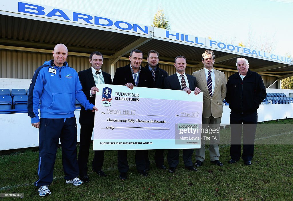 Aidy Boothroyd (C) the regional Club Futures ambassador for the East Midlands pictured with Jamie Appleby, Senior Lecturer of Sport at stephenson College, Russell Boam, Vice Chairman of Bardon Hill FC, Rob Middleton, Bardon Hill FC manager, Shaun Forrester, Club Chairman of Bardon Hill FC, Gareth Stratford, Works manager of Barden Hill Quarry and Donald Boam with their winning cheque during the Bud Club Futures event at Bardon Hill FC on December 5, 2012 in Coalville, England. Football life is set to change for Bardon Hill as Newcastle United boss Alan Pardew, Budweiser and The FA have today announced the winners of the £50,000 grants as part of the Budweiser Club Futures programme.