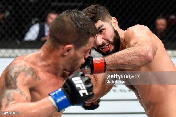 Aiemann Zahabi of Canada punches Reginaldo Vieira of Brazil in their bantamweight fight during the UFC Fight Night event inside the Scotiabank Centre...