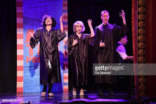 Aiesha Alia Dukes Mia Weinberger and Mitchel Kawash perform onstage during the 'ME THE PEOPLE The Trump America Musical' Press Preview Presentation...