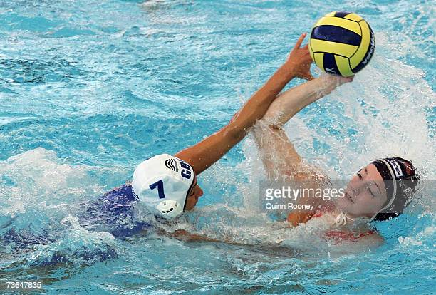 Aikaterini Oikonomopoulou of Greece defends against Iefke Van Belkum of Holland in the Women's Preliminary Round Group C Water Polo match between...