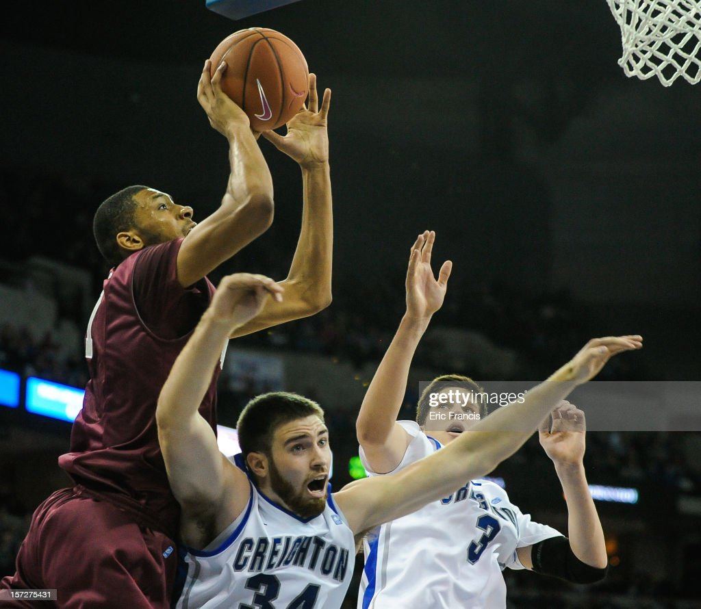 J Aiken of the Saint Joseph's Hawks shoots over Ethan Wragge and Doug McDermott of the Creighton Bluejays during their game at CenturyLink Center on...