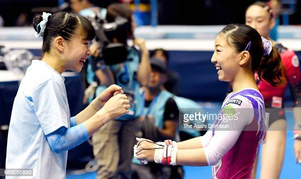 Aiko Sugihara celebrates with Asuka Teramoto after competing in the Uneven Bars of the Women's AllAround during day two of the Artistic Gymnastics...