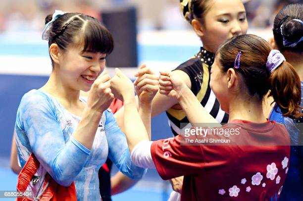Aiko Sugihara celebrates with Asuka Teramoto while competing in the Women's AllAround during day two of the Artistic Gymnastics NHK Trophy at the...