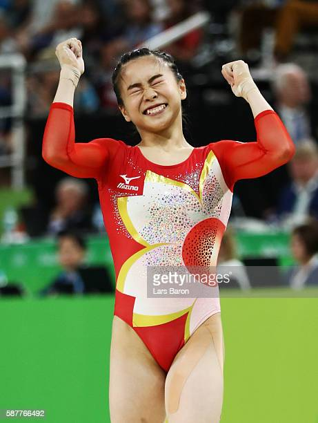 Aiko Sugihara of Japan celebrates after competing on the balance beam during the Artistic Gymnastics Women's Team Final on Day 4 of the Rio 2016...