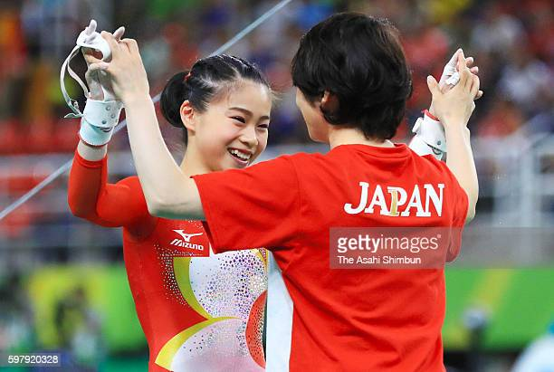 Aiko Sugihara of Japan celebrates after competing on the uneven bars of the Artistic Gymnastics Women's Team Final on Day 4 of the Rio 2016 Olympic...