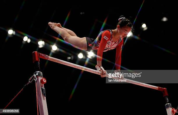 Aiko Sugihara of Japan goes through her routine on the Uneven Bars during Day One of the 2015 World Artistic Gymnastics Championships at The SSE...