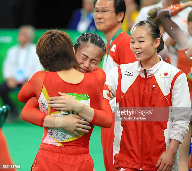 Aiko Sugihara of Japan is embraced by Mai Murakami after competing in the balance beam during the Artistic Gymnastics Women's Team Final on Day 4 of...