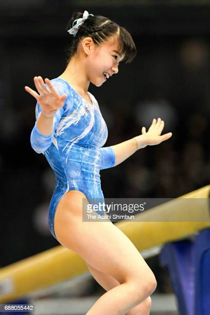 Aiko Sugihara reacts after competing in the Balance Beam of the Women's AllAround during day two of the Artistic Gymnastics NHK Trophy at the Tokyo...
