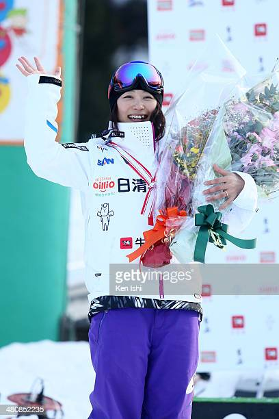 Aiko Uemura of Japan celebrates at podium after winning the competition during the Women's Finals of the All Japan Freestyle Ski Championships at the...