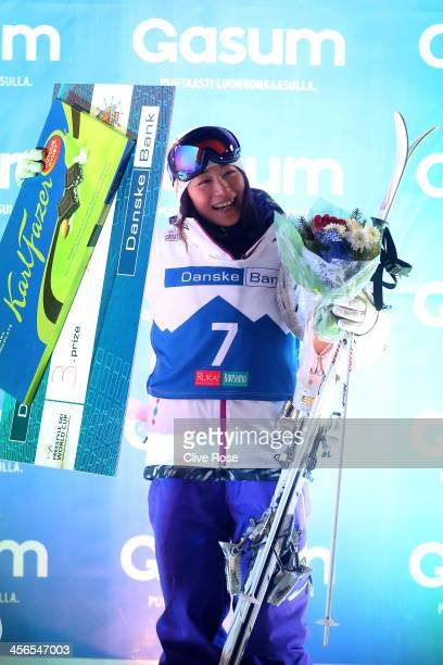 Aiko Uemura of Japan celebrates on the podium after finishing third in the Ladies Moguls competition during the FIS Freestyle Ski World Cup Ruka on...