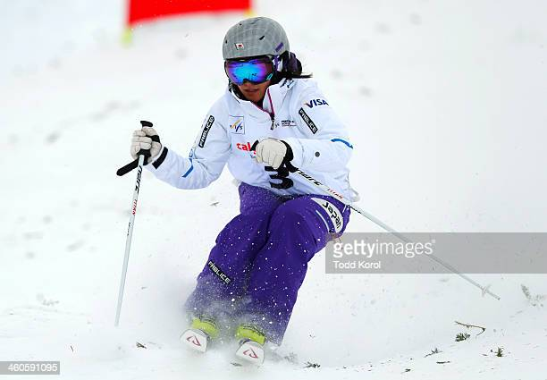 Aiko Uemura of Japan competes during the women's moguls finals at the FIS Freestyle Ski World Cup January 4 2014 in Calgary Alberta Canada