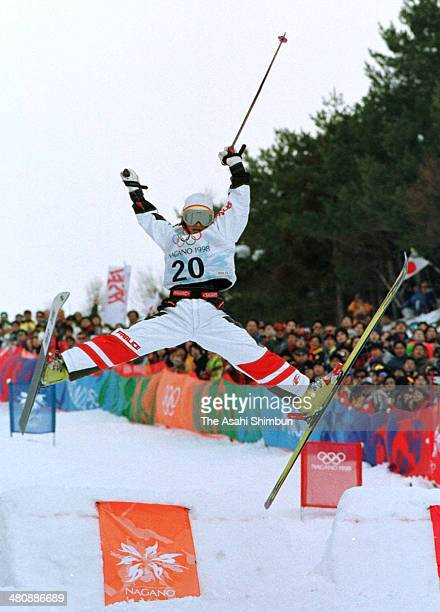 Aiko Uemura of Japan competes in the Ladies' Mogul qualification of the Nagano Winter Olympics at Iizuna Kogen Ski Resort on February 8 1998 in...
