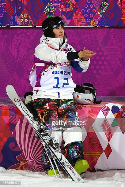 Aiko Uemura of Japan reacts after her Ladies' Moguls Final 3 run on day one of the Sochi 2014 Winter Olympics at Rosa Khutor Extreme Park on February...