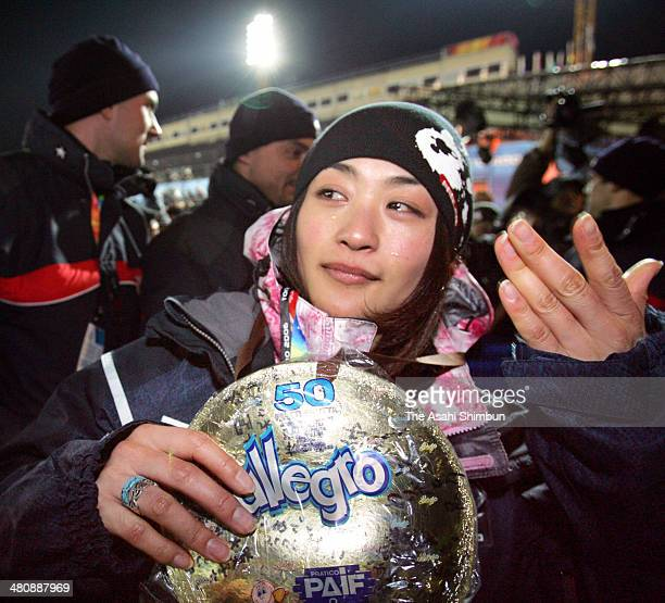 Aiko Uemura of Japan reacts after receiving hand made medal by her mother and friends after the women's freestyle skiing moguls final during the...