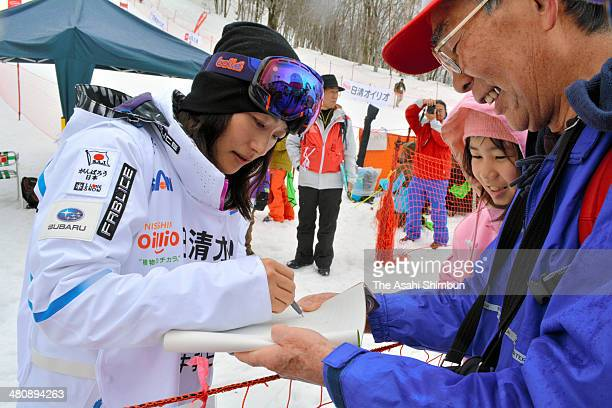 Aiko Uemura of Japan signs autographs for fans after the qualification during the Women's Finals of the All Japan Freestyle Ski Championships at the...