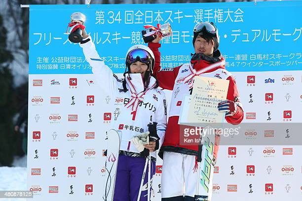 Aiko Uemura of Japan women's first place and Sho Endo of Japan men's first place pose for photo at podium after competition of the Women's and Men's...