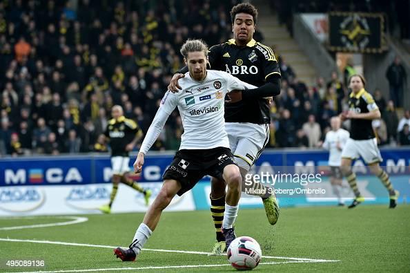 AIKs number 18 Noah Sonko Sundberg and Orebros number 16 Daniel Nordmark during the match between Orebro SK and AIK at Behrn Arena on October 31 2015...