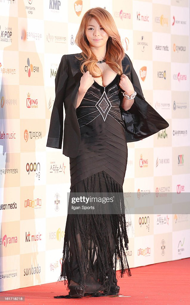 Ailee poses for photographs upon arrival during '2nd Gaonchart K-pop Awards' at Olympic Hall on February 13, 2013 in Seoul, South Korea.