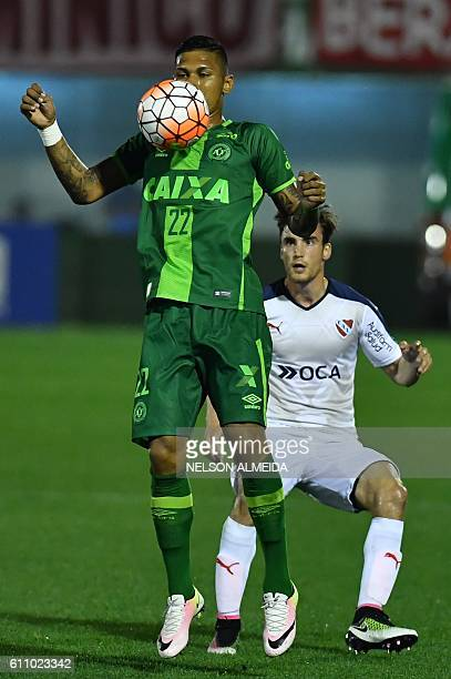 Ailton Canela of Brazil's Chapecoense controls the ball as Nicolas Tagliafico of Argentina's Independiente looks on during their Sudamericana Cup...