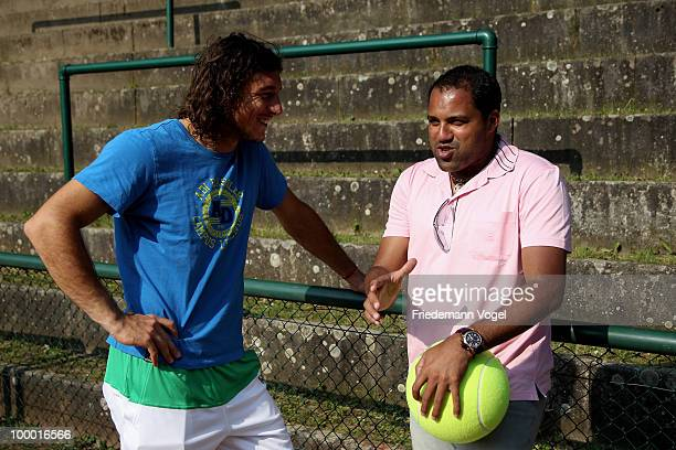 Ailton of Brazil and Juan Monaco of Argentina chat during day five of the ARAG World Team Cup at the Rochusclub on May 20 2010 in Duesseldorf Germany