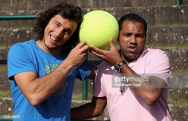 Ailton of Brazil and Juan Monaco of Argentina pose during day five of the ARAG World Team Cup at the Rochusclub on May 20 2010 in Duesseldorf Germany