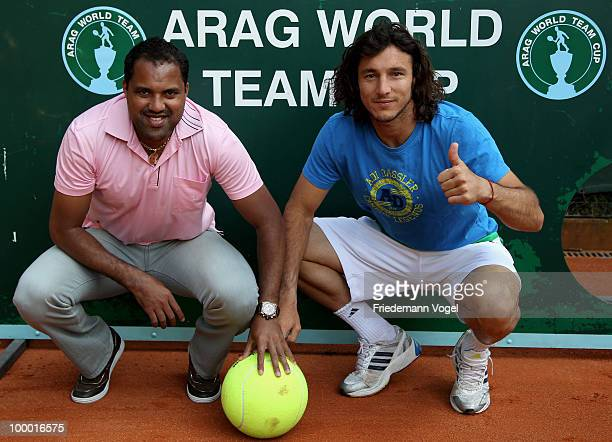 Ailton of Brazil and Juan Monaco of Argentina pose infront of the goal wall during day five of the ARAG World Team Cup at the Rochusclub on May 20...