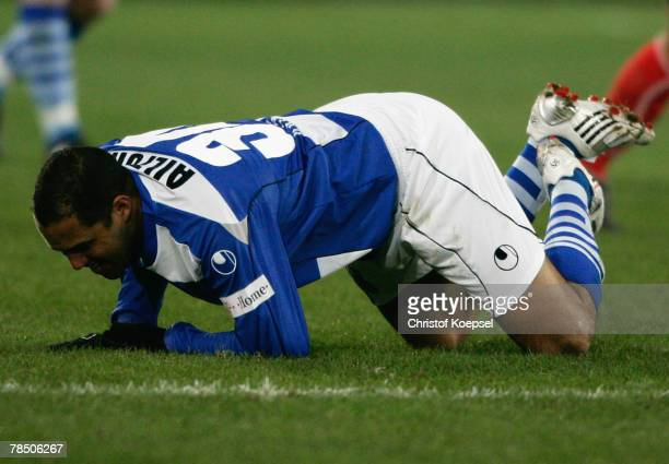 Ailton of Duisburg lies on the pitch during the Bundesliga match between MSV Duisburg and Eintracht Frankfurt at the MSV Arena on December 16 2007 in...