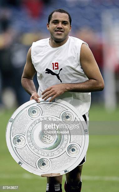 Ailton of Hambnurg holds a copy of the champion trophy after the Bundesliga match between MSV Duisburg and Hamburger SV at the MSV Arena on April 15...