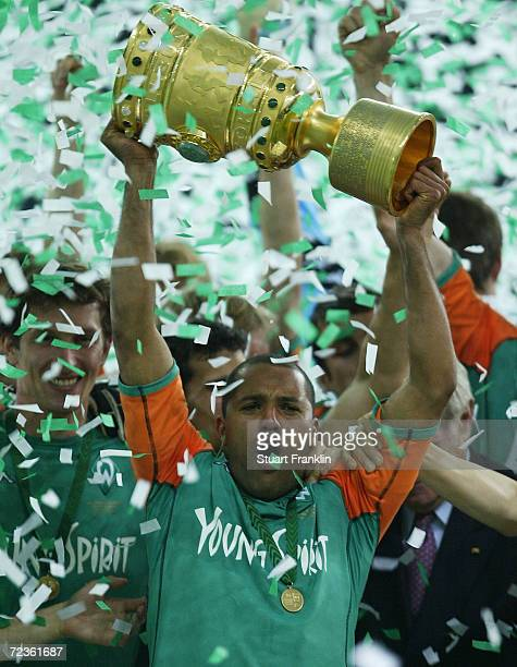 Ailton of Werder Bremen celebrates winning The DFB Pokal Final between Werder Bremen and Alemania Aachen at The Olympic Stadium May 29 2004 in Berlin...