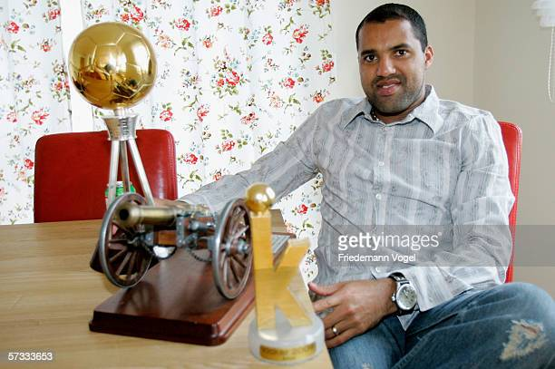 Ailton poses with his trophies during a photocall at his house on April 6 2006 in Hamburg Germany