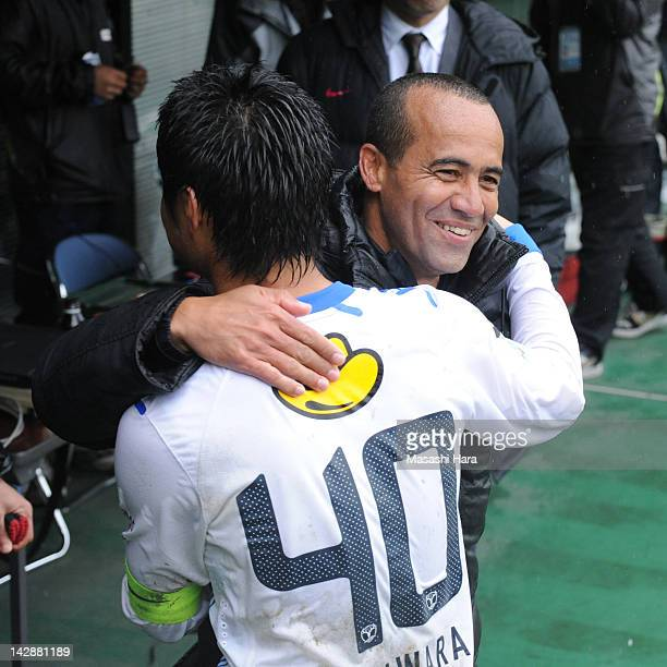 Ailtoncoach of Kashima Antlers and Mitsuo Ogasawara celebrate the victory after the JLeague match between FC Tokyo and Kashima Antlers at Ajinomoto...